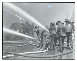 Portland? firefighters manning hoses