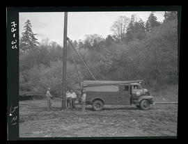 Men with utility pole
