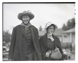 Two people in pioneer-themed costumes at parade