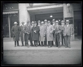 Group of men posing outside Multnomah Hotel, Portland