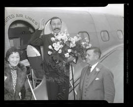 Unidentified man and woman with Joseph K. Carson at airport