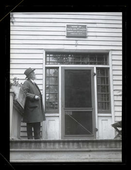 Unidentified man standing outside door of John McLoughlin House, Oregon City