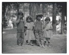 Four unidentified Native American girls in front of tree