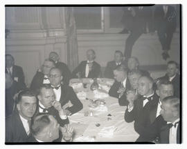 Unidentified men at formal event