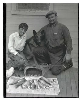 Man and boy posing with their catch