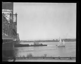 Boats passing under lifted Interstate Bridge span