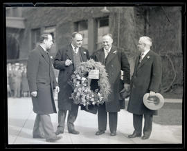 George L. Baker and three unidentified men at Union Station, Portland?