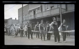 Men in parade, possibly in Astoria