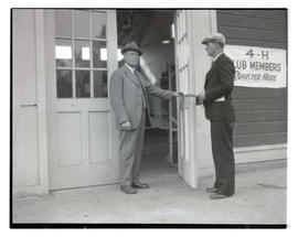 Two men at door of building
