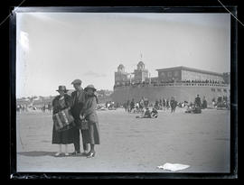 Three unidentified people on beach at Seaside, Oregon