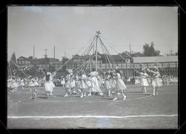Maypole dancers performing at Multnomah Field during Portland Rose Festival