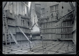 Station E, oil tank during construction while reinforcing rods