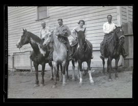 Four people on horseback