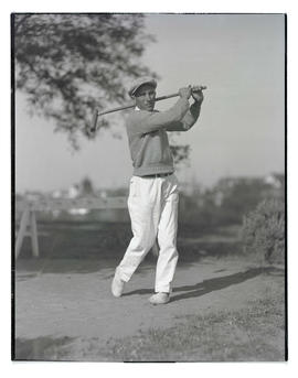 Unidentified golfer? posing with wooden club