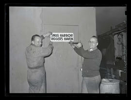 Workers with sign at Albina Engine & Machine Works, Portland