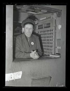 Worker in booth during graveyard shift at Albina Engine & Machine Works, Portland