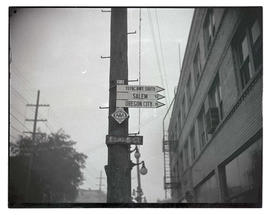 Road signs on utility pole at East Davis Street