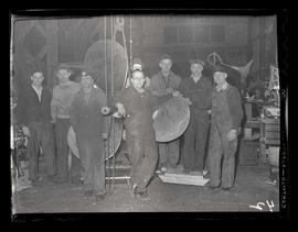 Workers posing with ship propeller, Albina Engine & Machine Works, Portland