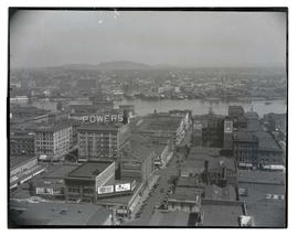 View of downtown Portland buildings and Willamette River from 5th and Taylor