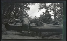 Phoebe Katherine Finley and an unidentified man with a canoe