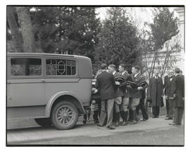 Pallbearers lifting casket of Governor Isaac L. Patterson into hearse after funeral at Oregon Sta...