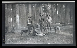Kelley, Gadsby, and Rees with a dead cougar and bobcat