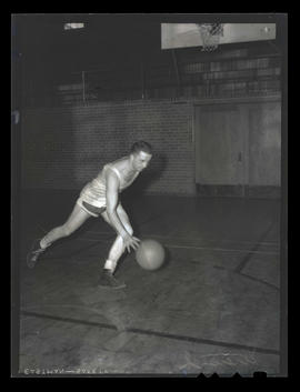 Maurie Stremich?, basketball player for Albina Hellships, dribbling ball