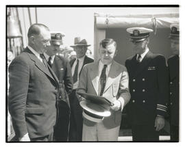 Mayor Joseph K. Carson presenting plaque to Lieutenant Commander Henry Hartley aboard USS Constit...