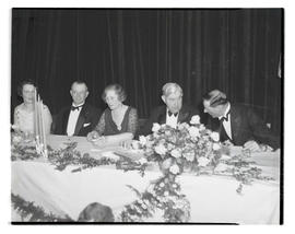 Unidentified diners at table during formal event