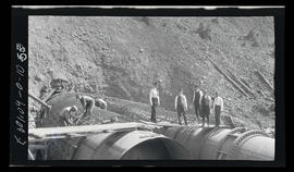 Oak Grove project, group standing on pipe at lower portal of tunnel #2