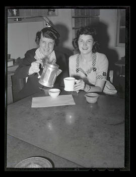 Two employees having coffee or tea, Albina Engine & Machine Works, Portland