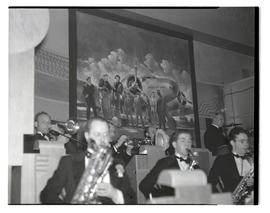Band performing in front of United Air Lines painting