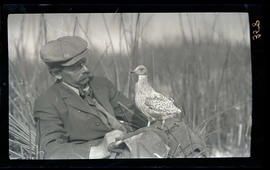 Dallas Lore Sharp with a juvenal gull
