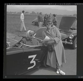 Two women with sports car at auto races in Tillamook, June 1955