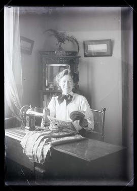 Maud Bohlman at a sewing machine