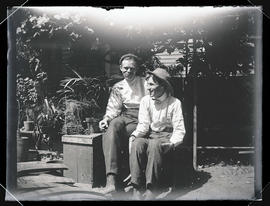 Finley and Bohlman sitting in a garden